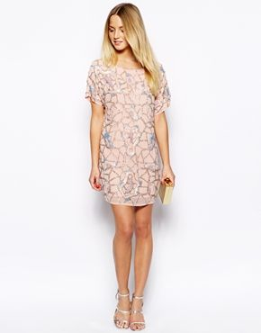 Image 4 of ASOS PETITE Exclusive Mini Dress With Cut Out Back In Heavy Embellishment