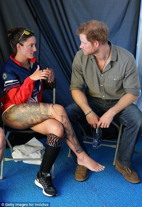 Prince Harry took some time to chat to US swimming team member who showed off her impressive leg tattoos
