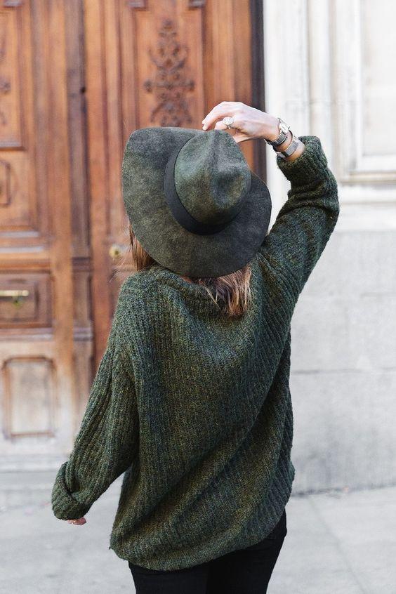 dark green sweater and hat