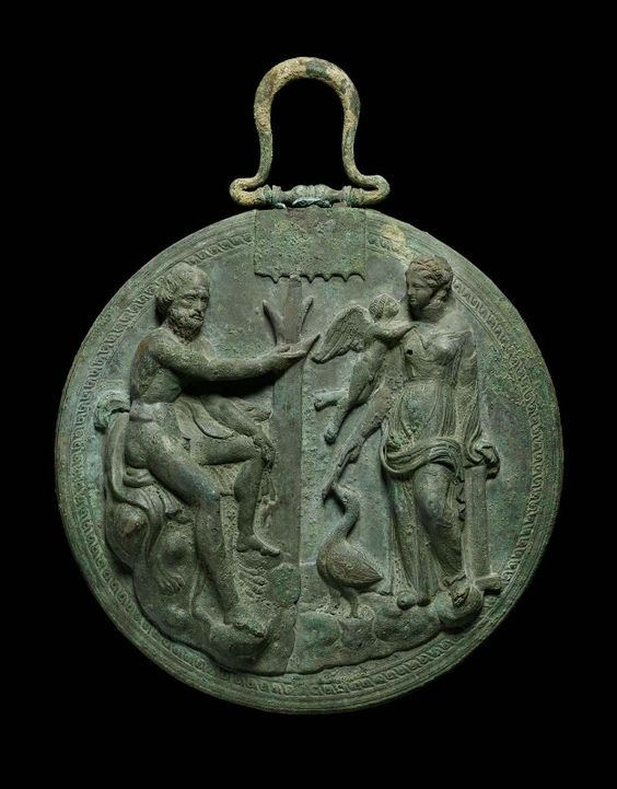 Bronze mirror cover with Aphrodite and a satyr. Greek. Early Hellenistic Period…