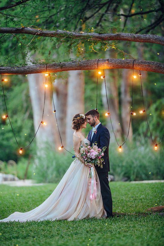 Whimsical wedding backdrop with bistro lights | Christina Carroll Photography