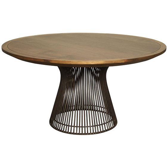"The Thomas Dining Table by Noir emphasizes natural, simple and classic design.  Noir has been designing, building and importing a very unique, but ever growing collection of home furnishings for more than 10 years. 60"" top  <i><font color=""gray""><b>Wood type:</b></font> Walnut and Metal <font color=""gray""><b>Finish:</b></font>  Dark Walnut</i>  <i>Noir products are hand finished and created with a concentrated effort toward environmental sustainability. Variations could occur and are not ..."