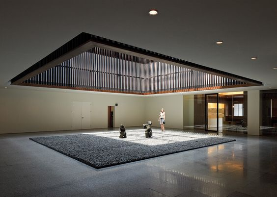 Interpretations of Chinese courtyards begin with a large rectangular garden contained at the heart of the building. Meanwhile, a top-lit atrium is located on the eastern side of the plan and forms the centre point for four smaller indoor courts.