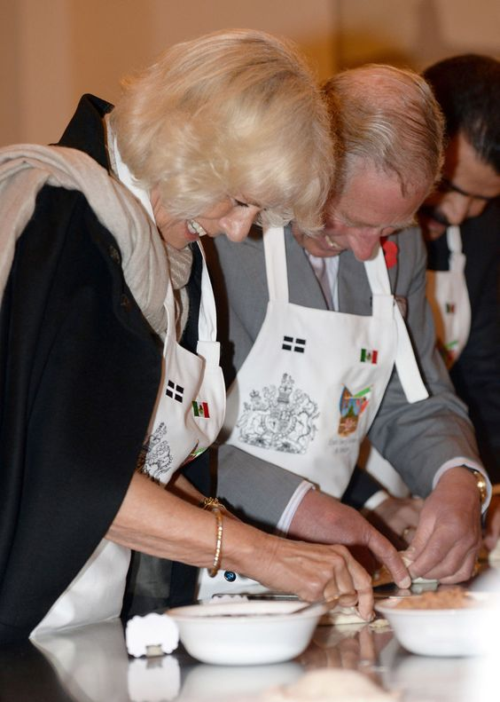 Prince Of Wales And The Duchess Of Cornwall Visit Mexico - Day 1.....Prince Charles, Prince of Wales and Camilla, Duchess of Cornwall make pasties during their visit to the Pasty Museum in Real del Monte on the 'Day of the Dead' on November 2, 2014 in Hidalgo, Mexico.