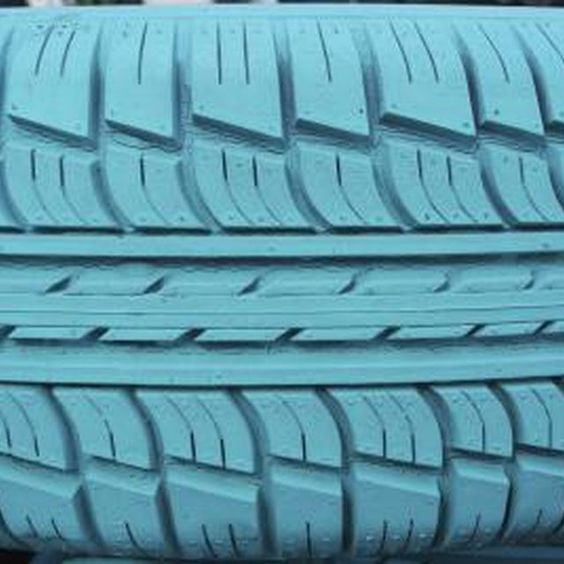 A non-toxic outdoor paint is typically recommended for painting tires.