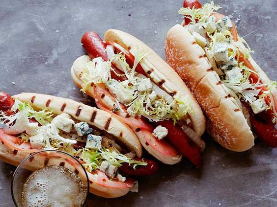 Put a sophisticated spin on classic cookout food by loading hot dogs with Gorgonzola, marinated tomatoes, grilled onion and frisee. #GrillingCentral