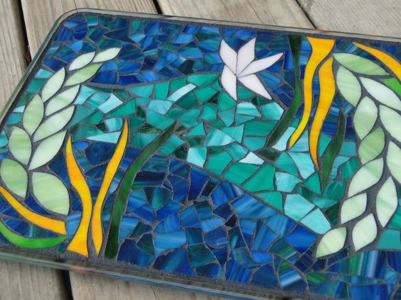 "Resin covered Large Stained Glass Mosaic Trivet Candle Plate Platter cobalt blue teal turquoise green""Under the Sea"". $150.00, via Etsy."