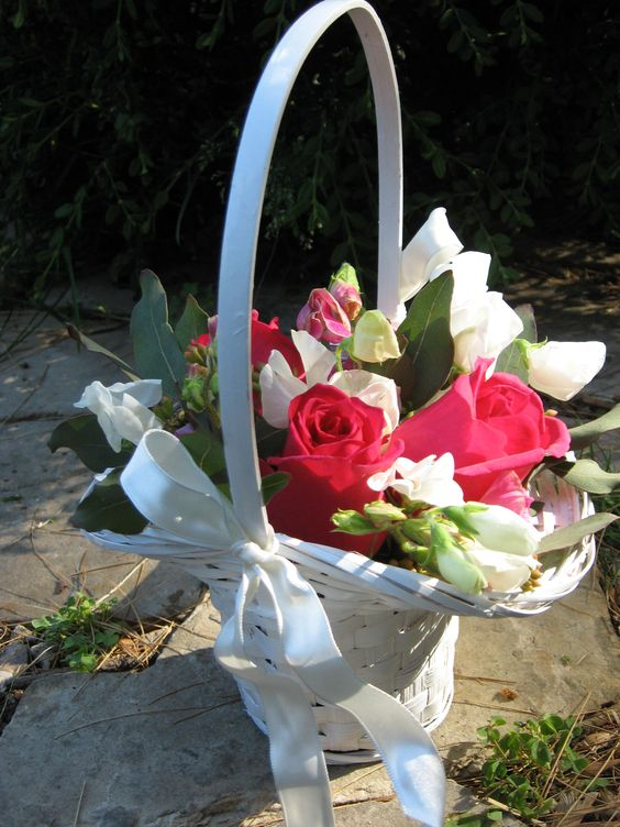 Our flower girl baskets with mixed flowers. This is a fixed arrangement, perfect for a little girl who is too shy to sprinkle petals down an aisle.