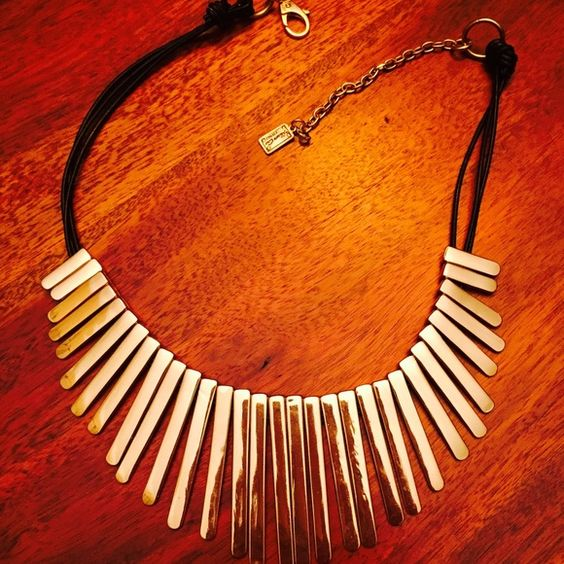 Kenneth Cole gorgeous gold tone necklace!  ✨Kenneth Cole gorgeous gold tone necklace with black leather string. A beauty. Worn once.  Kenneth Cole Jewelry Necklaces