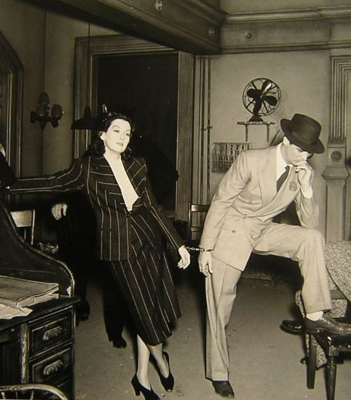 Rosalind Russell and Cary Grant take a break on the set of His Girl Friday (1940).