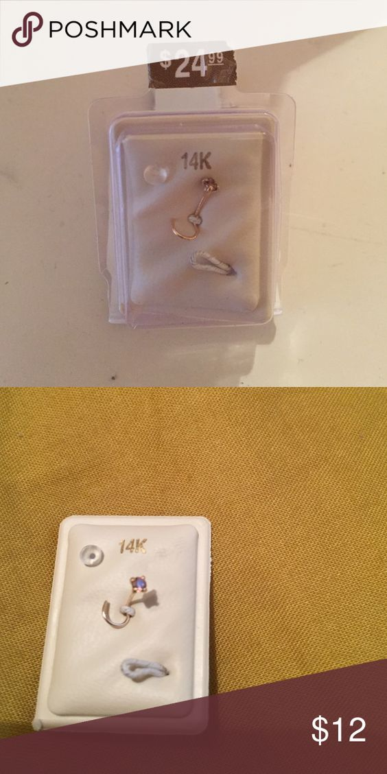 2 nose rings never used piercing pagoda 14 kt gold nose ring with pink stud and 1 clear plastic nose ring. Jewelry