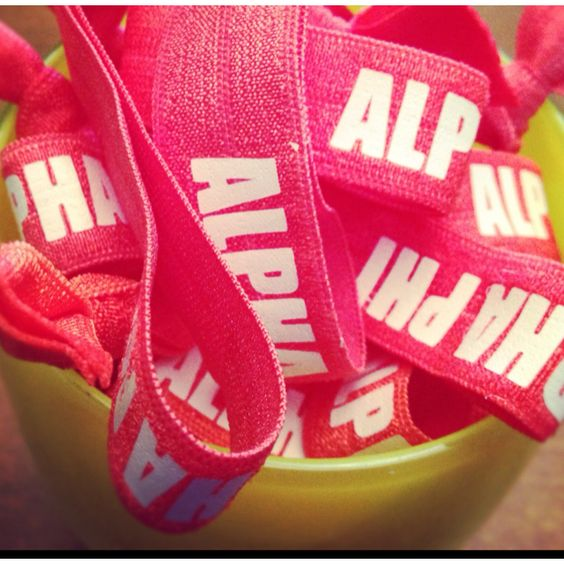 this idea would be cute for workout headbands! i need a pi phi one :)