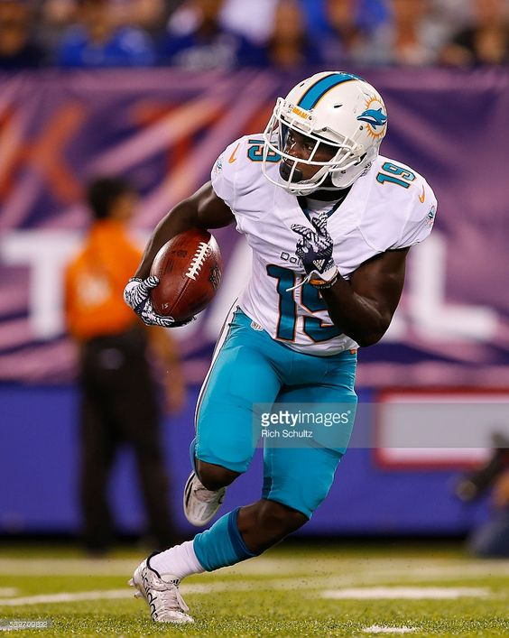 fde3c568c ... Jakeem Grant 19 of the Miami Dolphins returns a kick during the first  half against ...