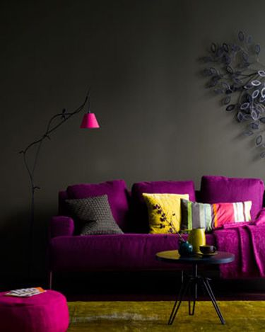 Love it! Dark walls with bright furniture accents.