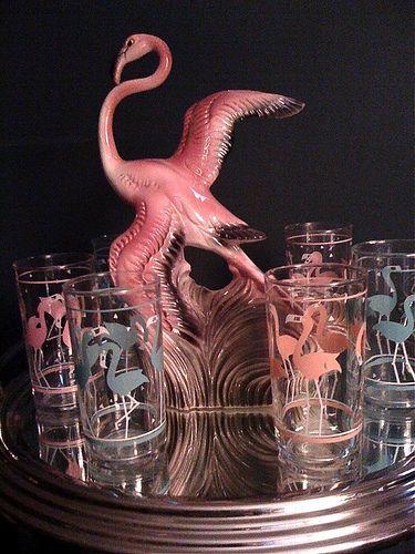 1950s pink flamingo figurine with a flamingo glass set. Photo by UrbaniteRetro via Flickr.