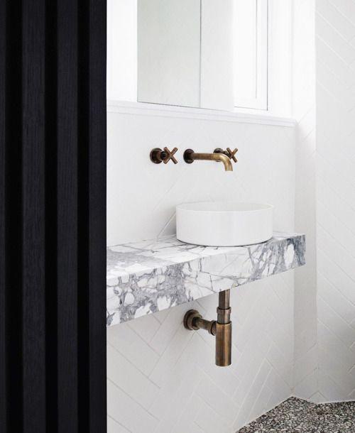 Washroom. WC. Toilet. Vanity. Marble. Countertop sink. Brass taps.