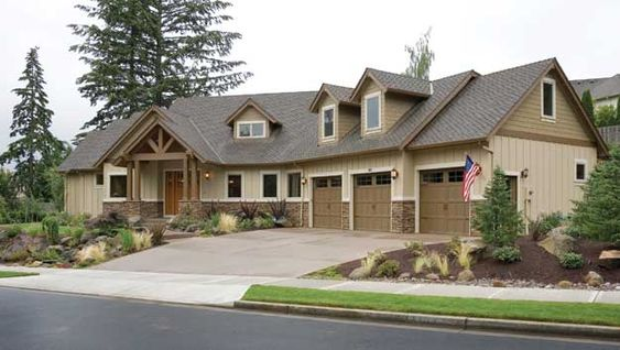 Charming dormers with brackets, a sprawling three-car garage, provides curb appeal to this craftsman style home.  Craftsman House Plan # 441287.