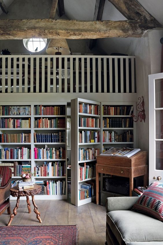 Love this set up- gallery shelves hide secret bathroom and there's gallery bed space above (Emma Burns' barn)