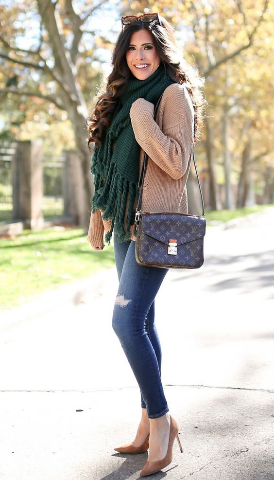 Hunter green tassel scarf, beige sweater and pumps as worn by Emily