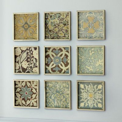 Scrapbook paper and dollar store frames...beautiful:) Great idea for artwork for little money and big impact.