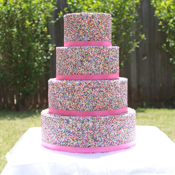 This would make an awesome little girls birthday cake!! 4 tier Sprinkle covered cake By bellacakecreations on CakeCentral.com