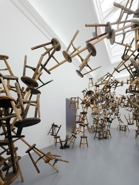 Ai Wewei's art installation of 886 hanging wooden stools taken from schools that collapsed during the devastating 2008 earthquake in China.