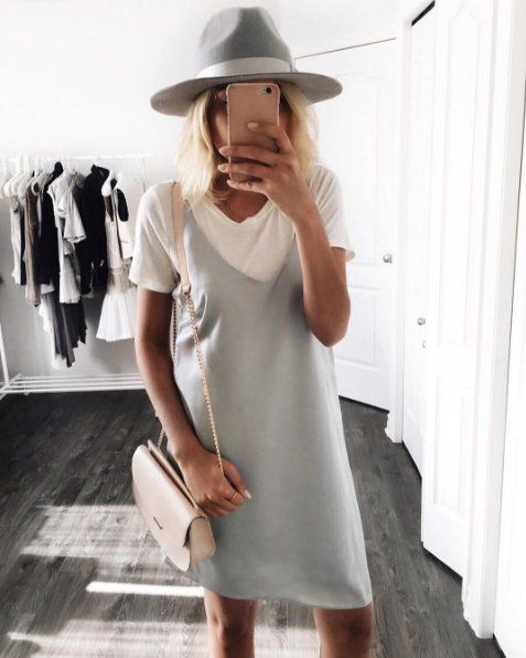 Layer again here with a tee. Top it off with a wool fedora and a soft-colored crossbody bag.:
