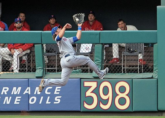 Game 8. 4/14/12. Nieuwenhuis makes a leaping catch, robbing Brian Schneider of a hit. (US Presswire) From CSNPhilly.com