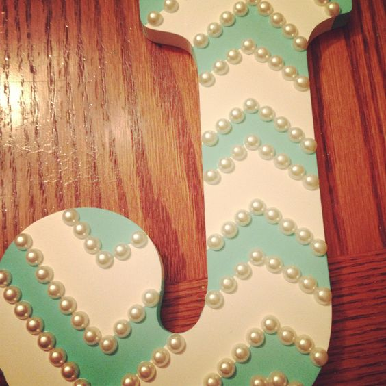 Wooden letter, painters tape, aqua paint, and pearls