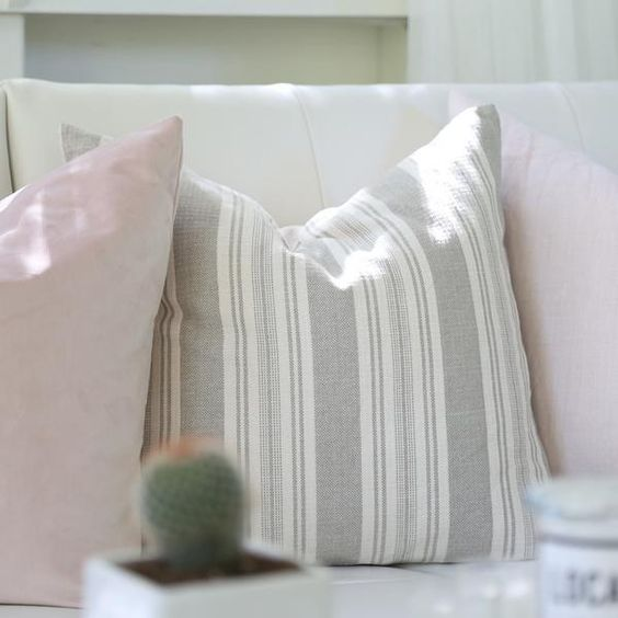 Classic grey + white stripe pillow with blush pink pillows. Click to buy - we ship worldwide! www.tonicliving.com