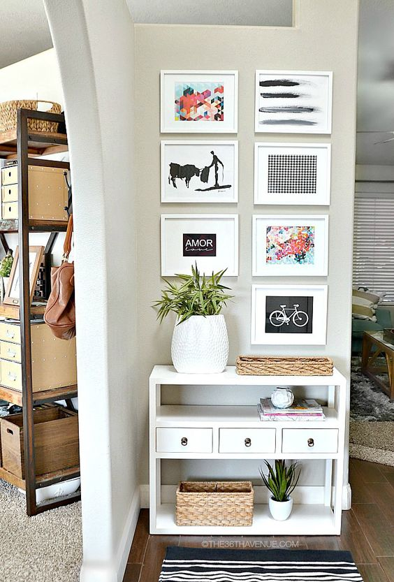 Instead of placing your photos and art sporadically around the room, cluster them together. This move deliberately defines a wall as your entry, sectioning it off from the rest of an open layout. See more at The 36th Avenue »   - HouseBeautiful.com: