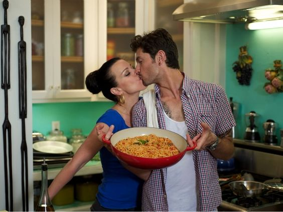 Actress Debi Mazar and Gabriele Corcos, from the show Extra Virgin.  They are so cute and he is adorable!