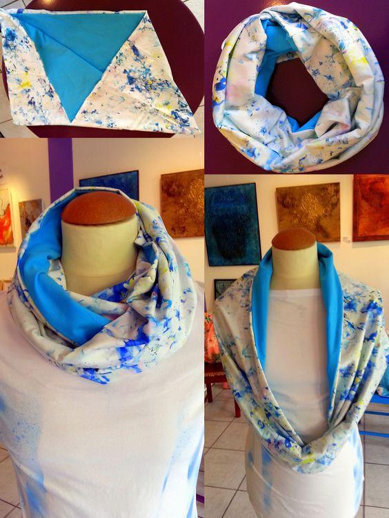 Hellblauer Jersey-Stoff. Oberer Stoff weiss mit Hellblauen gelben Blümchen. Baumwolle-Satin Grösse: 140x40cm Preis: Fr. 42.00