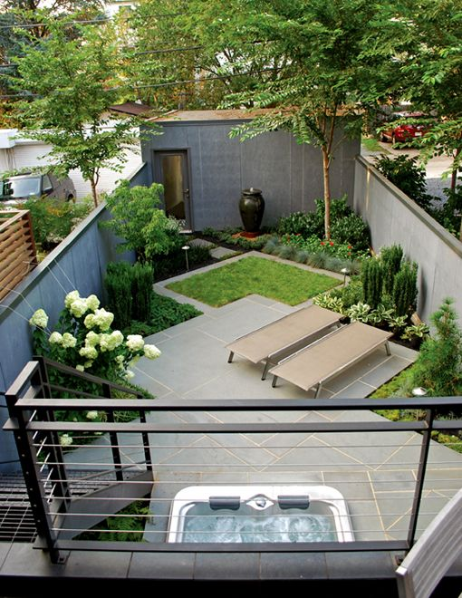 Small garden with sun area and even a small lawn and shed - Good design in a small space, although slightly too much Gary paving for my taste