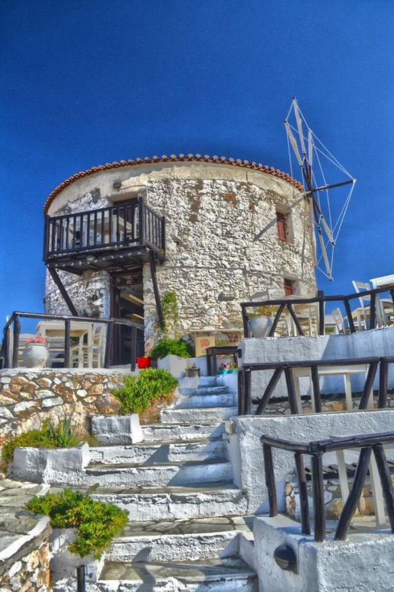 A windmill turned into a traditional tavern in Skiathos, Greece