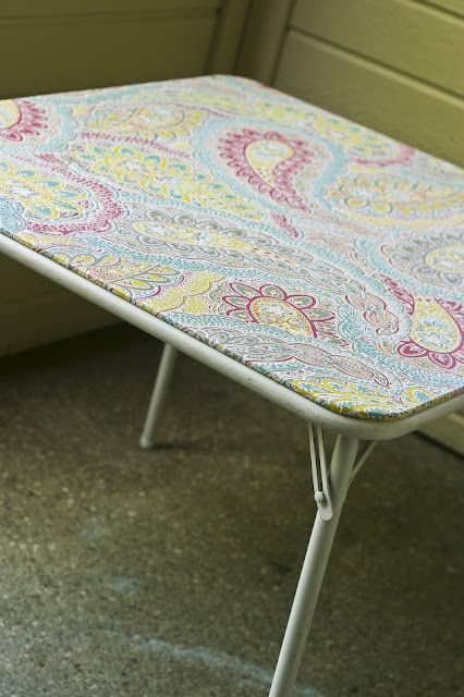 Card table makeover: unscrew the top, remove the vinyl, replace with tablecloth.
