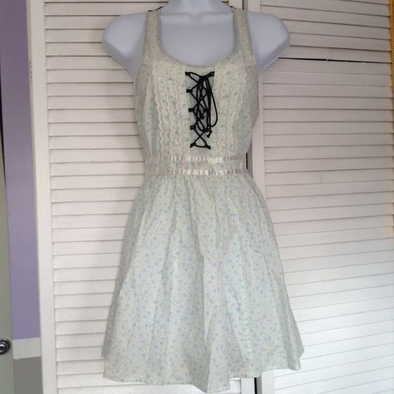 Cute Dress Adorable little floral pastel dress with a corset from and sheer mesh back! Very fresh and lightweight! Sizd extra small. Great condition! Dresses Mini