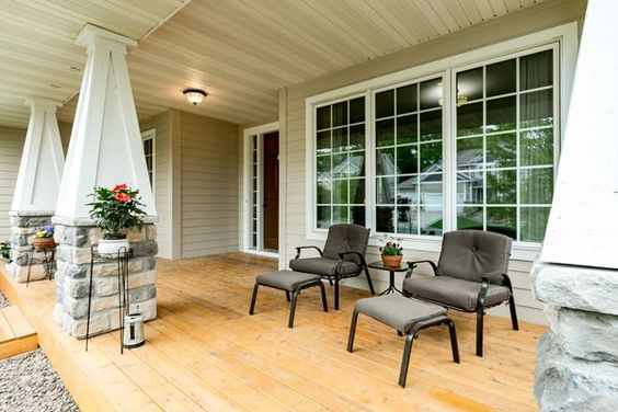 This new cedar porch measures 29 feet and is a comfortable width to move around furniture comfortably.   This porch can be found at 14013 Kings Court in Savage.  Chad & Sara Huebener, Edina Realty.