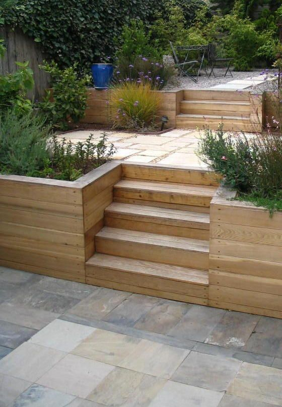 I like the simplicity of the plain wood with stone pavers for Terrace steps