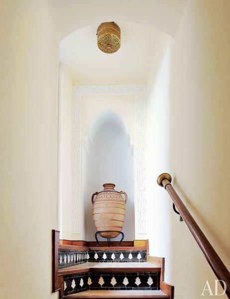 A Berber jar occupies a staircase niche | archdigest.com