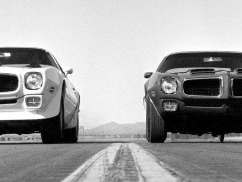 Poncho Drag Race, actually two 70's era Firebirds. Love it.