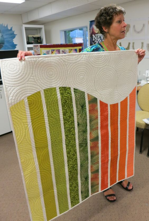 Central Florida Modern Quilt Guild...hey, that's Linda! and a neat modern quilt design -- I would love this in a queen bed size with solid shams that pull from the colors in the quilt, but use the same circular top stitching!