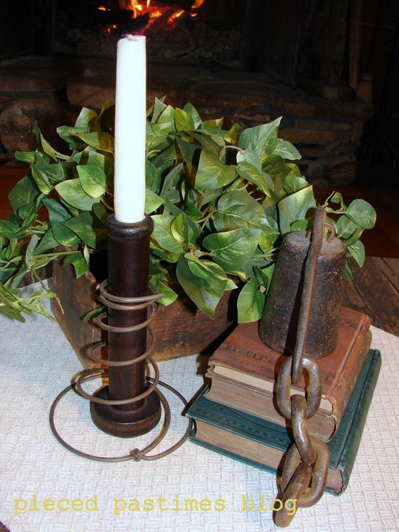 Old rusty bed spring wrapped around an old spool as a candle holder...brilliant!
