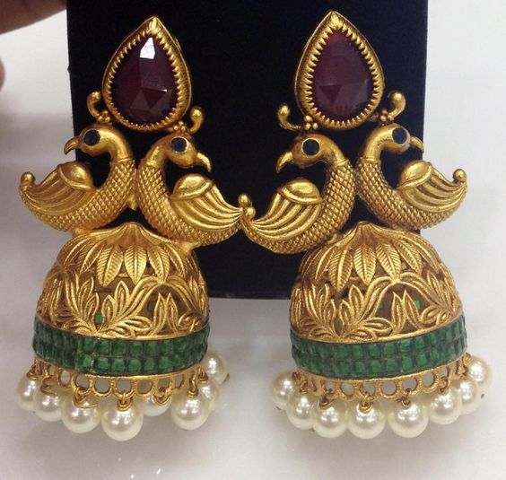 http://swarnakshi.com/product/antique-ruby-peacock-top-with-emerald-jhumkas/: