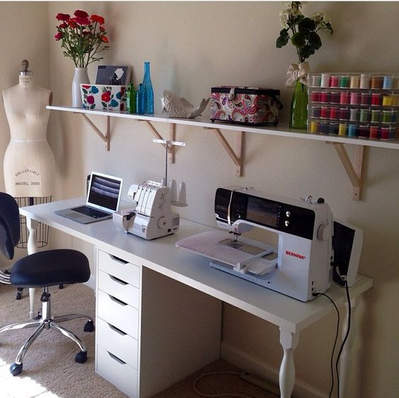 Sewing space.... This is exactly what I need!!! Except have the drawers on one side not in the middle.: