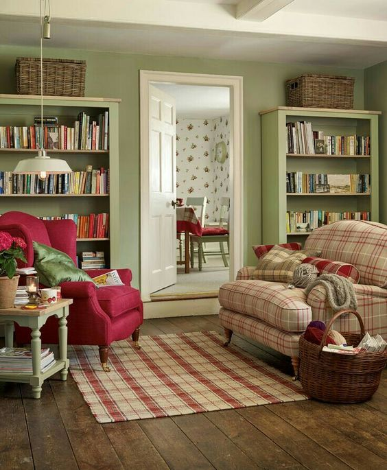 Loving the plaid chair and the cool green walls!: