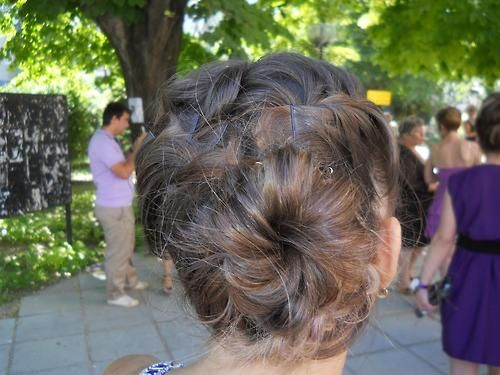 Spiral bun. Curl hair, put into pony tail, twist and pin up.
