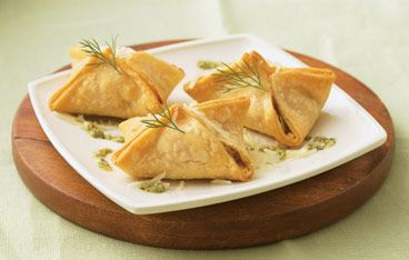 Salmon Pastries with Dill Pesto Recipe: Each little appetizer bundle is bursting with salmon and cheesy-dill flavors.