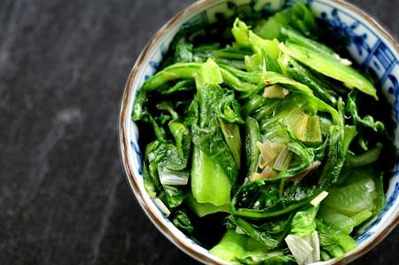 Peppery mustard greens simply sauteed with onions, garlic, and olive oil and a dash of sesame oil to finish.