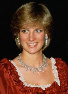 The King Khalid of Saudi Arabia Diamond Necklace.  This necklace was made by Harry Winston and was given to QEII when she made a State visit to Saudi Arabia in February, 1979. The Queen loaned it to the Princess on at least three occasions during 1982 and 1983. Diana wears it with the diamond and pearl drop earrings, a wedding present from the Emir of Qatar.